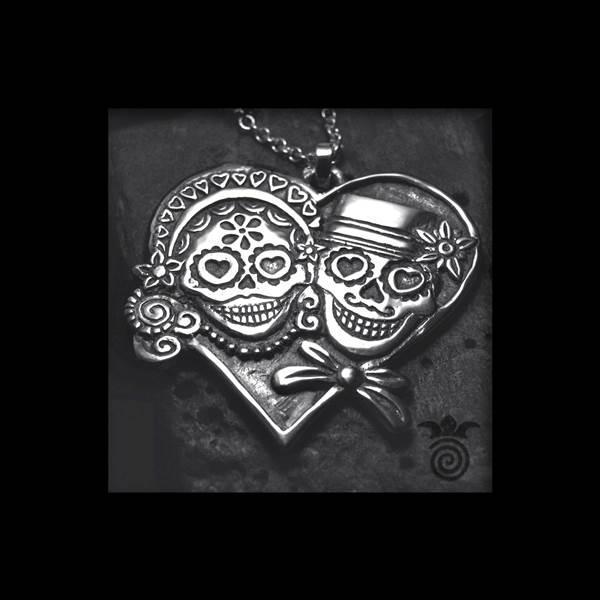 Pendentif couple de maries têtes de mort argent